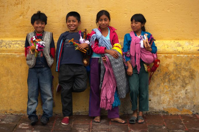 Young street sellers of San Cristobal